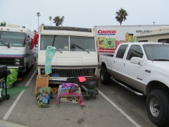 Experienced parking lot campers leave room at the front for necessities.  (Note Costco delivery truck in background.)